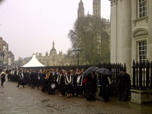 snow falls on the graduates
